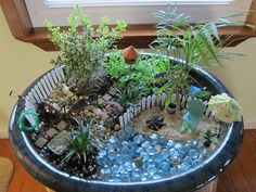 Your kids can create a miniature garden in a large planter - let their imaginations run wild!