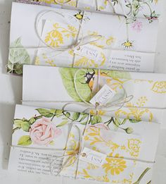 emma cassi - Made with vintage children books,  yellow velvet printed paper, lilac tags and white linen cord.