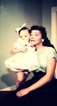 Beautiful photograph of Correta Scott King and her lovely daughter.