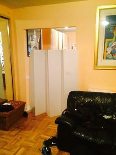 Cardboard room dividers, double sided in white. Great way to separate an entry way from two rooms.