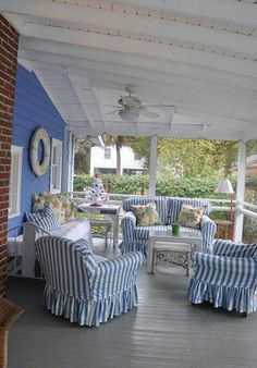 Comfy Cottage style porch~ I'm hoping the fabric on the furniture is made of Sunbrella outdoor fabric.