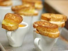 Mini grilled cheese sandwiches with petite yellow tomato soup from @Mandy Dewey Seasons Hotel Washington. A great idea for a party appetizer on a cool summer evening.