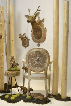 Fauna made from Flora. An assortment of busts,animals and furniture made from pinecone bracts, moss, and lichen made by Catherine Greenup.