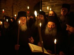"""On the holy peninsula of Mount Athos, monks chant """"Christos anesti — Christ is risen"""" during a midnight vigil. This Easter gathering ends seven weeks of solemn fasting. Monks rise to pray during the quietest hours of the night because that is when they believe the heart is most open."""