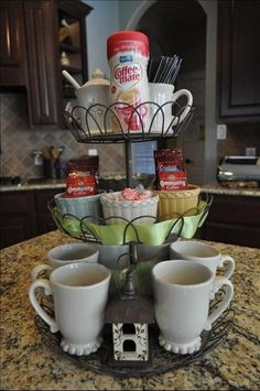 {inspired} DIY countertop tea station: cups on bottom - variety of teabags in middle - honey, sugar, fresh lemons in bowl on top #teatime