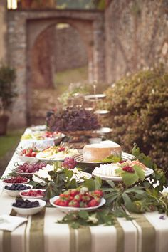 buffet table with fruit and cheese