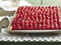 Fresh Raspberry Almond Tray Tart - An almond cookie crust goes perfectly with sweetened cream cheese topped off with raspberries and a touch of honey.