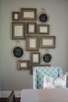 old family recipes in weathered frames from Hobby Lobby; burlap stretched across the back and recipes are just tacked on top (like the look of the gallery wall in general)