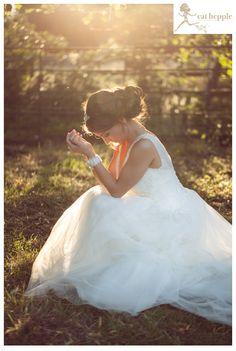 Bride wearing Lusan Mandongus.  Sunset, sunflare, stillness.  Cat Hepple Photography