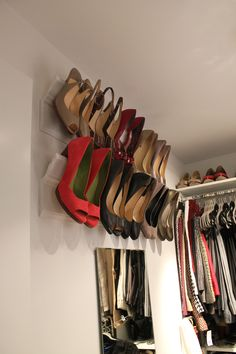 Crown Molding Shoe Shelves- perfect space saver storage.    Total Cost $20  $8- 8' base pine base molding and $9- 8' crown molding + white spray paint.  Wood glue crown on to base molding, finish nail to hold in place while drying, spray paint, install w/ 2 screws onto wall studs. @Mary Hickox