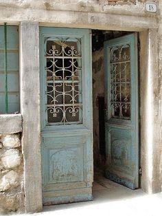 Blue doors with iron grates.