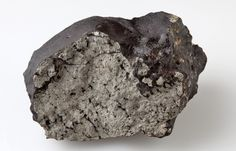 This 1.1-kilogram chunk of the Tissint Martian meteorite (fell in the Moroccan desert on 2011) shows distinct charring from Earth's atmosphere and pockets of black glass that contain trapped gas from Mars. Credit: Natural History Museum, London.