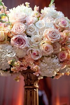 Flowers in creams and whites, shimmering gold Chivari chairs | Wedding Reception | Exquisite Events | Tara Arrowood