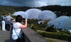 My friend Lisa and the Eden Project domes/biomes. Hexagons tessellate. Pentagons interspersed in the structure make it curve. Via @Gwenelope