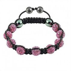 Beautiful magenta shamballa beads woven together with black thread.   These shamballa bracelets are handmade and are of the highest order when   it comes to quality. These bracelets are suitable for everyday wear and   are an awesome way to complete a fashionable look. Our beads are made   out of clay, resin or precious/semi-precious metals.