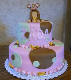 Baby girl monkey baby shower cake