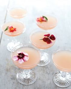 Ruby red grapefruit juice and Lillet Rose give these gin cocktails their delicate blush.