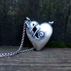 Dark Sea Sutured Heart necklace by idle hands designs