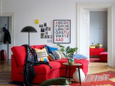 red couch, white walls