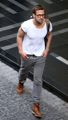 Shop this look for $162: http://lookastic.com/men/looks/white-crew-neck-t-shirt-and-grey-jeans-and-walnut-boots-and-olive-backpack/1146 — White Crew-neck T-shirt — Grey Jeans — Walnut Leather Boots — Olive Backpack