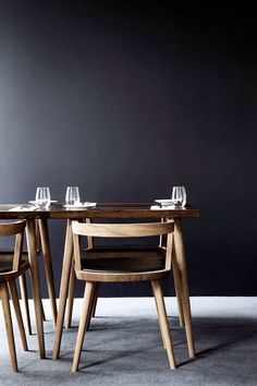 Black wall, wooden chairs in dinning room