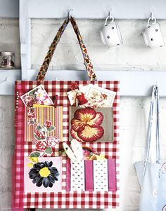 This portable crafts organizer starts with an inexpensive tote bag, or a square of fabric-covered cardboard.