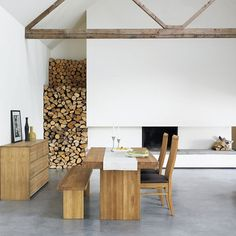 Love how the wood is stored inside tho' those white walls would not stay white for long