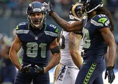 Getting it done when the pressure is on can be satisfying, just ask Seattle's Golden Tate after his big 31-yard gain in the third quarter netted congratulations from Sidney Rice. The Seahawks beat the Rams, 20-13. (Photo by Bettina Hansen / The Seattle Times)
