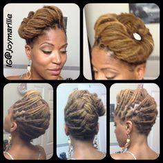 Joy Newton's locs updo hairstyle.