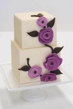 Simple purple floral block wedding cake.