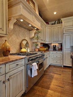 Love distressed white kitchen cabinets (with a black chunky island!)