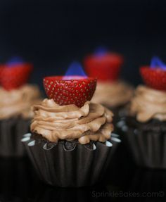 Chocolate Cupcakes with Flaming Strawberries. I MUST MAKE THESE.