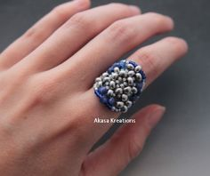 ‪#‎HEPTEAM‬  Silver and blue seed beaded mandala ring created by Aria Vaillancourt. US ring size 6.5 to 7.   https://www.etsy.com/listing/193480939/silver-beaded-mandala-ring-size-65-to-7?ref=shop_home_active_1