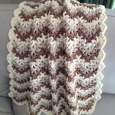 Last minute baby blanket from AnnabelsArmoire on Ravelry, uses Berocco comfort chunky yarn and a large size hook for a quick finish