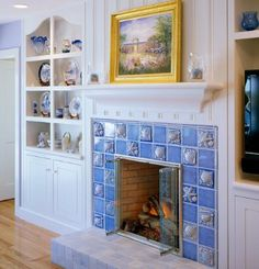 """...a charming hearth design by Polhemus Savery Da- Silva Architects for a New England coastal cottage.  It features a striking firebox surround of ocean blue field tiles and high relief accent tiles with sea life motifs.  Smaller square tiles in neutral shades clad a raised hearth."""