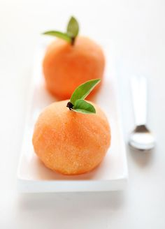 little scoops of citrus sorbet - these look like little peaches!