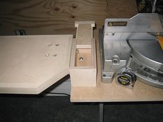 Miter saw stand with small toolbox for stop knobs & such