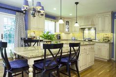 The blue and yellow French Country kitchen After