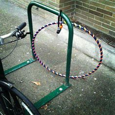 Someone locked their Hula-Hoop to a bike rack: