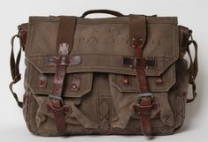 Ralph Lauren messenger bag w/ vintage leather straps. This would be a fantastic camera bag for travel!