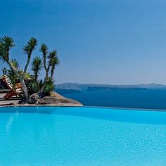 Perivolas Resort, Santorini, Greece. With unobstructed views of the Aegean Sea and neighboring Greek islands, this boutique resort's infinity pool is a paragon of relaxation. | Coastalliving.com