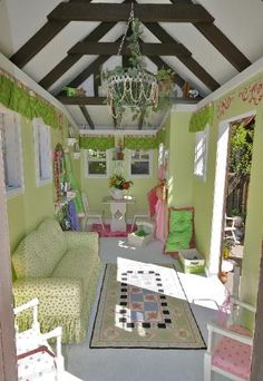Inside a outdoor playhouse...WOW!  This is nicer than my house!  !!!  Lol