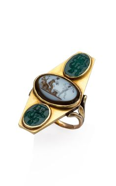 This antique 18-karat gold shield ring features three hand-carved chalcedony intaglios in a bezel setting  18-karat yellow gold with brown/white and green chalcedony  Made in Italy, circa 1890