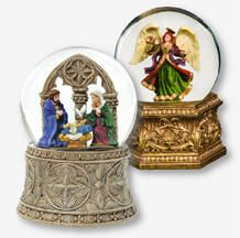 "Religious Musical Water Globes  from The San Francisco Music Box Company    Nativity Musical Water Globe, plays ""It Came Upon A Midnight Clear""; 5.75"" tall. (Item #11772) $34.95   Golden Opulence Angel Musical Water Globe, plays ""Hark, The Herald Angels Sing""; 5.5"" tall. (Item #11778) $34.95"