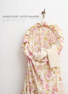 Use a pretty pillow case and an embroidery hoop to create a pretty hanging hamper