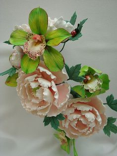 Peonies and Cymbidium Orchids by Sugar_Flower, via Flickr