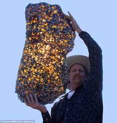 a slice of the Fukang meteorite - so beautiful!  When it slammed into the surface of Earth, there was little sign of the beauty that lay inside. But cutting the Fukang meteorite open yielded a breathtaking sight. Within the rock, translucent golden crystals of a mineral called olivine gleamed among a silvery honeycomb of nickel-iron.