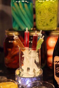 Serve shots in plastic syringes.