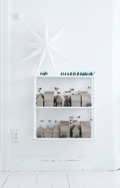 Nordic christmas inspiration, paper stars, little houses, advent calendars, christmas displays, christmas villages, modern christmas, cardboard houses, paper houses