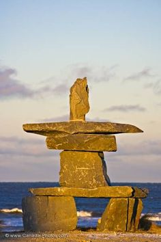 Inukshuk at sunset in the town of Churchill on the shores of Hudson Bay, Manitoba, Canada.